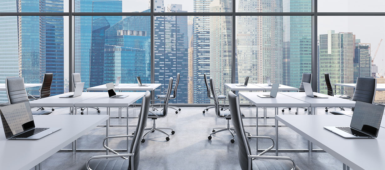 Workplaces in a modern panoramic office, Singapore city view
